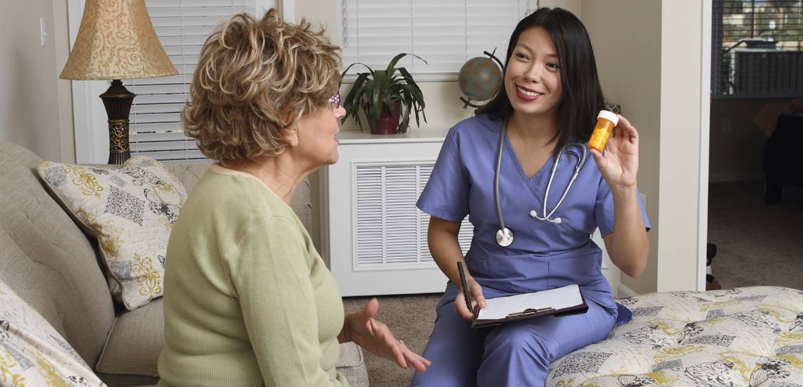 Home care provider discussing medication